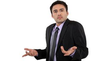 Geschäftsmann Mann Business sprachlos irritiert Frage verärgert Ärger sauer verwirrt